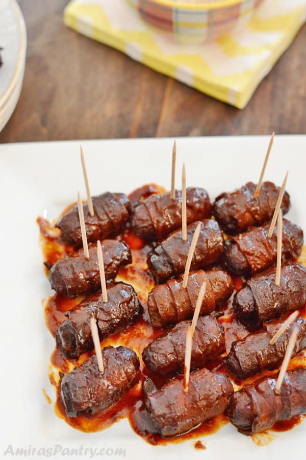 Embrace the sweeter side of the BBQ sauce and whip up a wonderful, easy appetizer for your next party. With the use of your crockpot, this becomes an almost effortless bacon wrapped smokies recipe