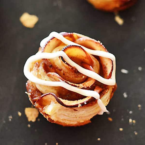 A close up of apple rose on a pan sheet