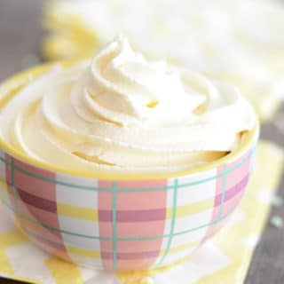 A cup filled with fluffy marshmallow butter cream