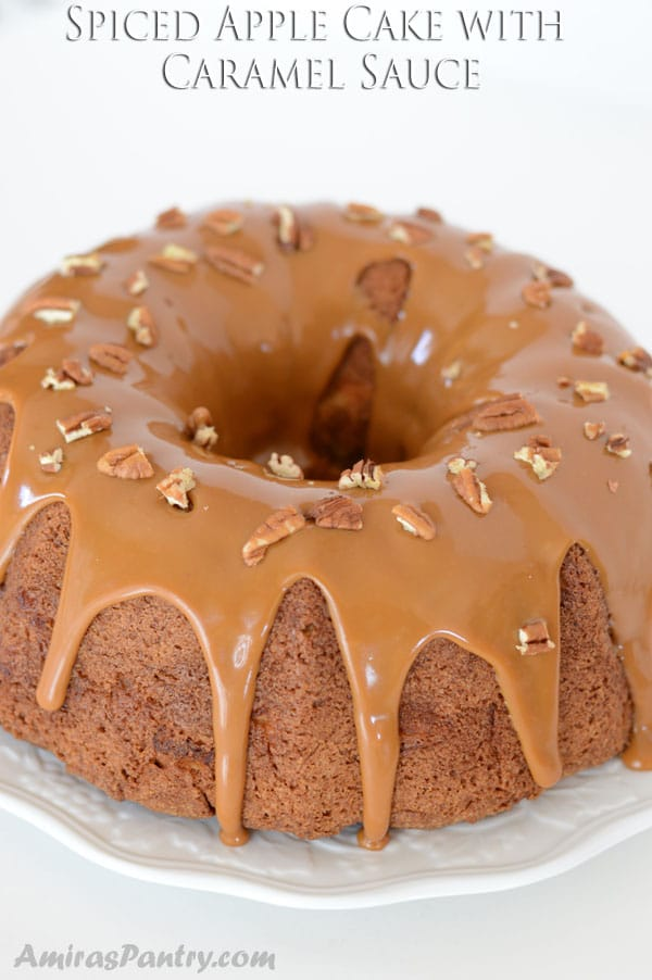 Chunky apple spice cake, filled with cream cheese, topped with caramel sauce and sprinkled with pecan. This warmly spiced apple bundt cake with caramel sauce is outrageously rich.