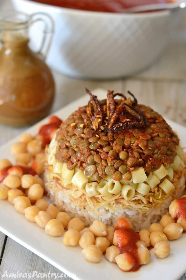 Koshari the national dish of egypt amiras pantry a plate of egyptian koshary topped with crunchy fried onions and chickpeas all around forumfinder Images