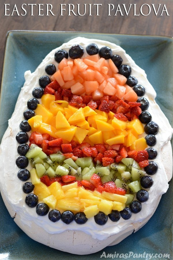 An easter-themed pavlova, perfectly crunchy on the outside with an inch of marshmallow fluff on the inside. Pavlova is the one of the best lowfat vehicles for easter fresh fruits with whipped cream.