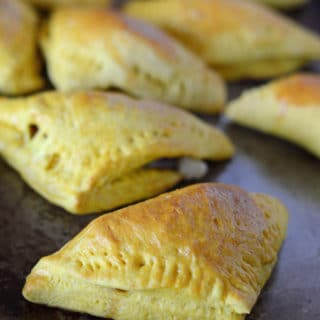 A close up of food, showing stuffed Egyptian Borek