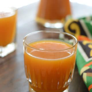 A close up of glass of apricot juice