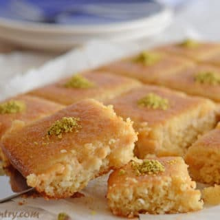 A plate of food, with Basbousa cake pieces