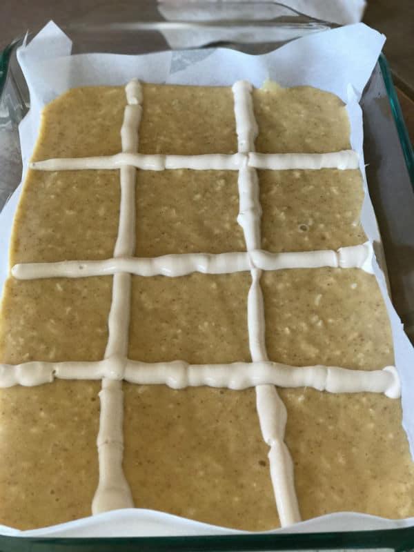 A close up of a pan with Babousa cake mixture