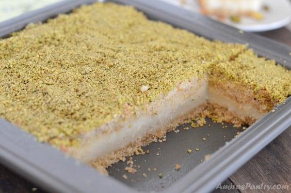 Semolina bars filled with delicious creamy Ashta. One of the best semolina flour recipes I've ever had. A delicious Lebanese treat with a new ashta recipe