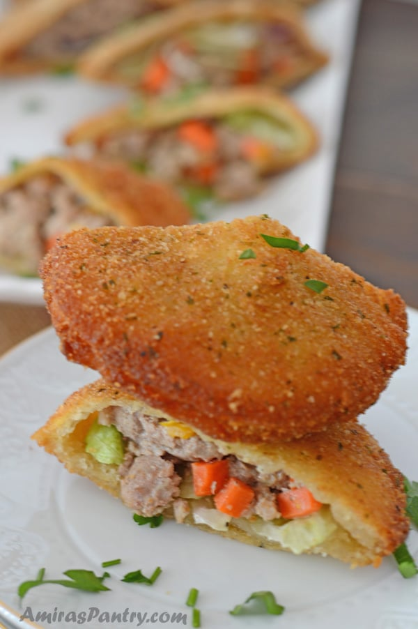 Merchant's pocket is a seriously delicious, fried sandwich pocket stuffed with your favorite filling. Here is mine stuffed with ground turkey and veggies mix. Merchant pocket sandwiches are what you'll need for your next gathering.