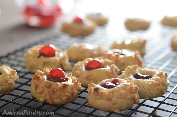 A close up of ruby gem thumbprint cookies