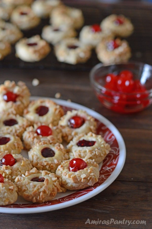 Perfectly soft and buttery cherry thumbprint cookies. These little gems are not too sweet and pairs very well with a cup of tea/coffee.