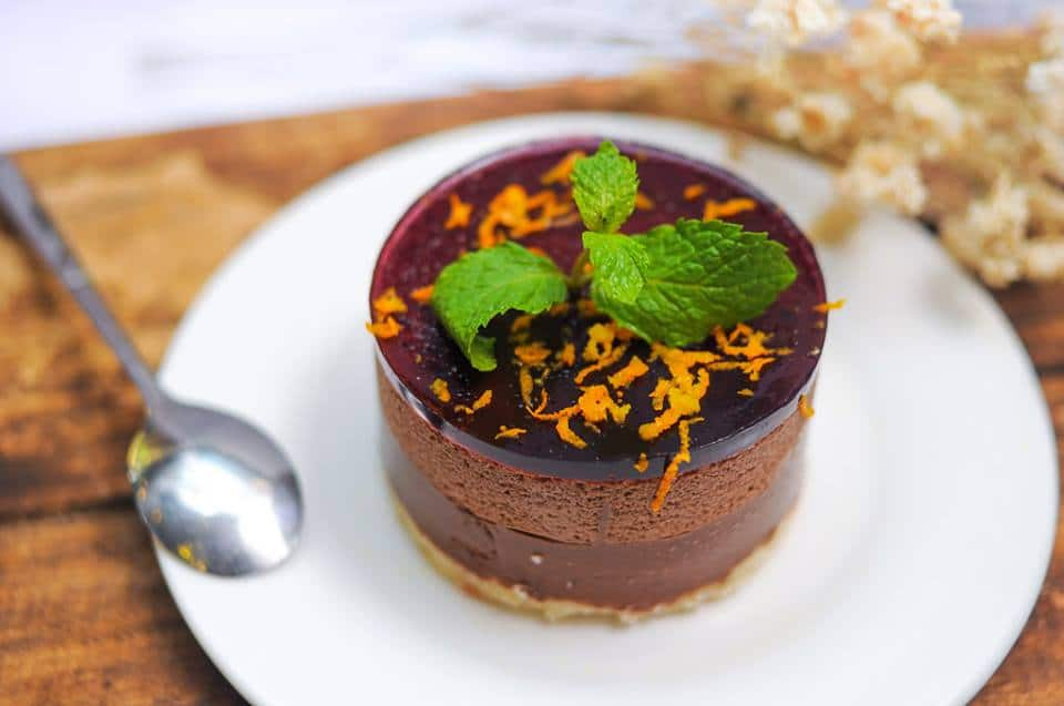 A close up of a piece of cake on a plate, with Mint and Mousse