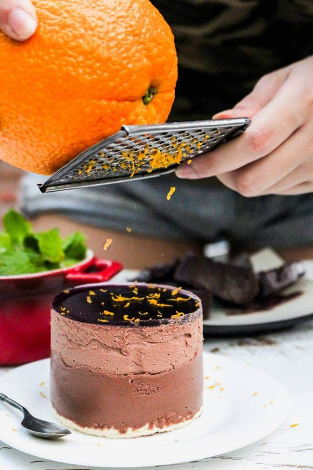 A close up of a cake with Mousse, orange and chocolate