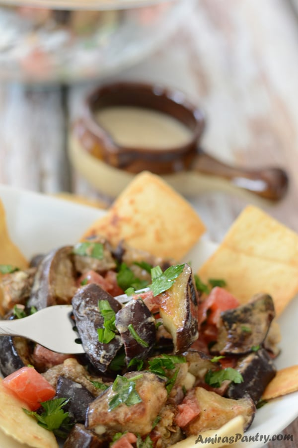 A cold eggplant salad recipe with yogurt and tahini dressing, full of flavors and textures.