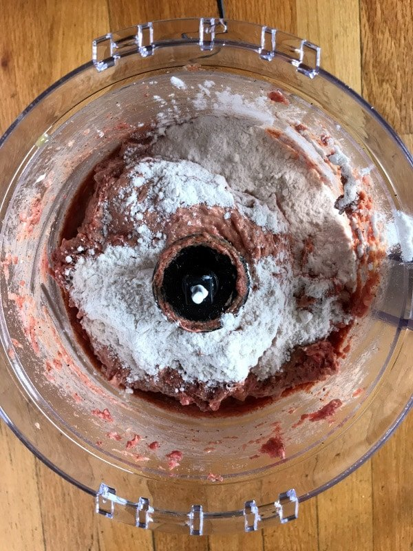 A photo showing a step mixing corned beef in a blender