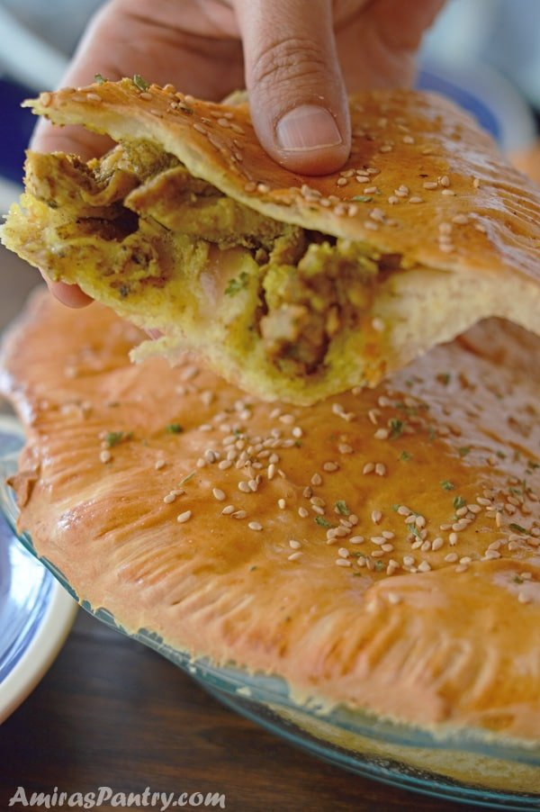 A close up of food, with Shawarma Chicken and bread