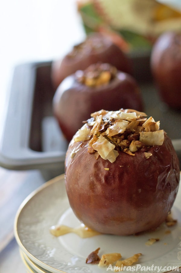 Treat yourself like royalty with these baked stuffed apples.This Middle Eastern classic flavored healthy baked apples combine the smooth taste of honey with walnut and of course, the pure joy of pistachio. You don't have to be a royalty to enjoy the luxury of Baklava Flavored apples; here is the recipe waiting for you.