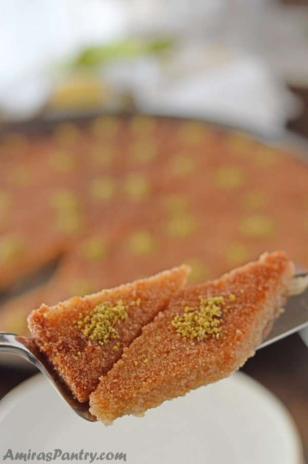 Basbousa cake, an Egyptian farina cake drizzled with simple syrup and traditionally served with a hot cup of black tea/coffee. Sweet, tender and delicious. No one can resist it.