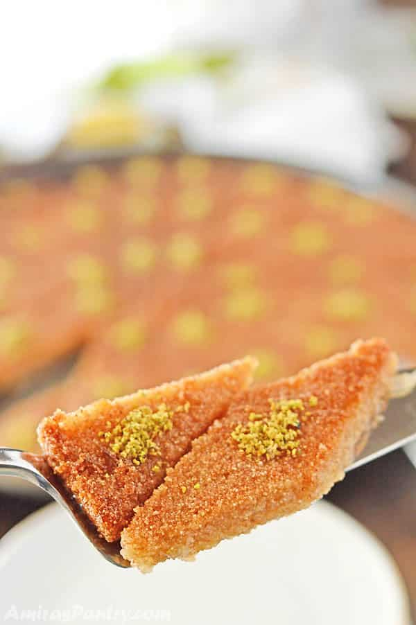 A close up of a slice cut out of Basbousa