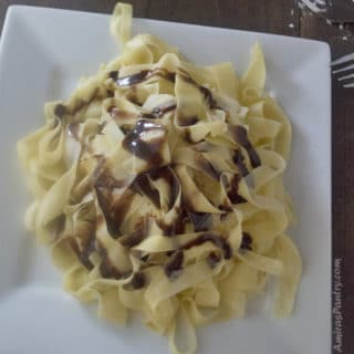 A close up of food, with Fettuccine
