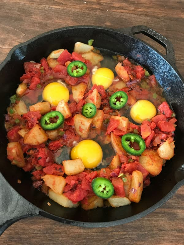 A pan filled with food, with Egg and vegetables