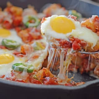 A pan is filled with food, with Egg, cheese and Potato