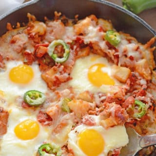 A dish is filled with food, with Egg, cheese and Potato
