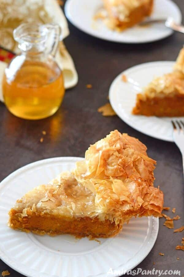 A close up of pumpkin phyllo pie piece on a plate