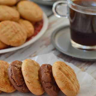 A plate of food and a cup of coffee, with Cookies