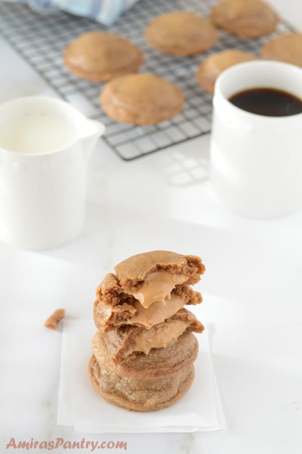 A close up of a peanut butter cookies and a cup of coffee