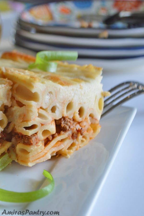 A close up of a piece of Baked Pasta with ground beef in a dish