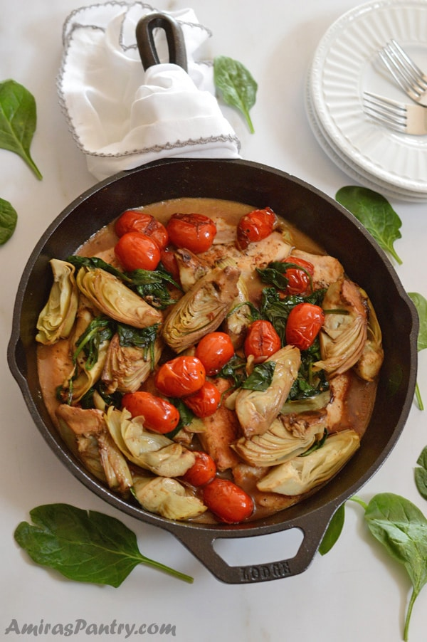 One skillet lemon artichoke chicken dinner, ready in 30 minutes. Add some spinach and tomato for some added colors and nutrients, serve with rice and you've got a drool worthy dinner.