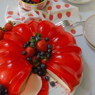 A plate of food on a table, with Jello and cream cheese