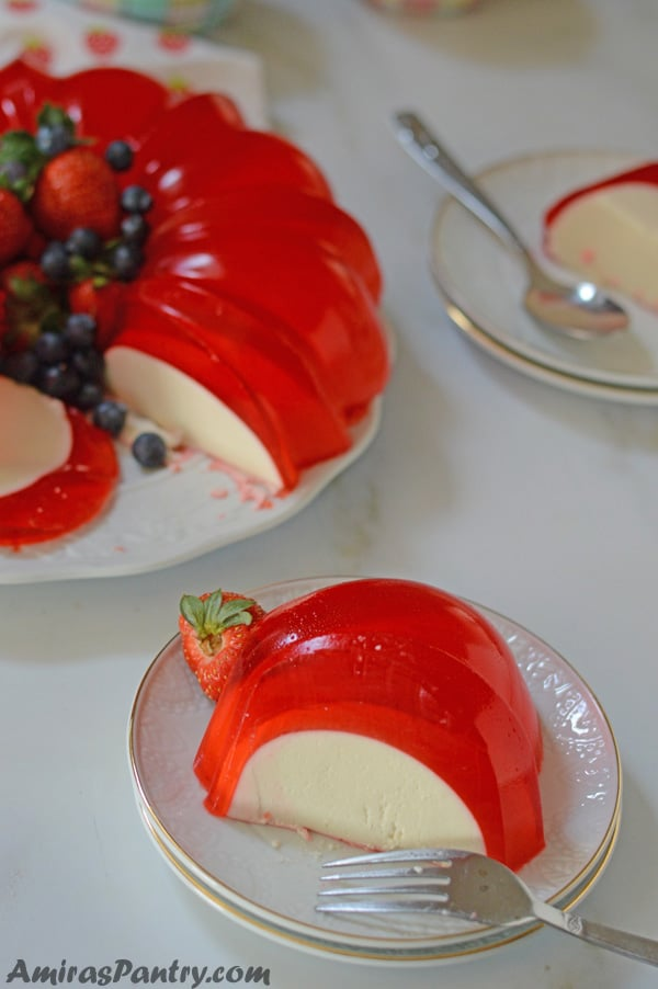 a piece of the bundt jello cut and served with another piece on the back.