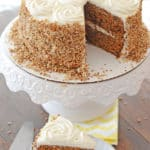 Healthier carrot cake on a platter with a piece of the cake on a small plate.