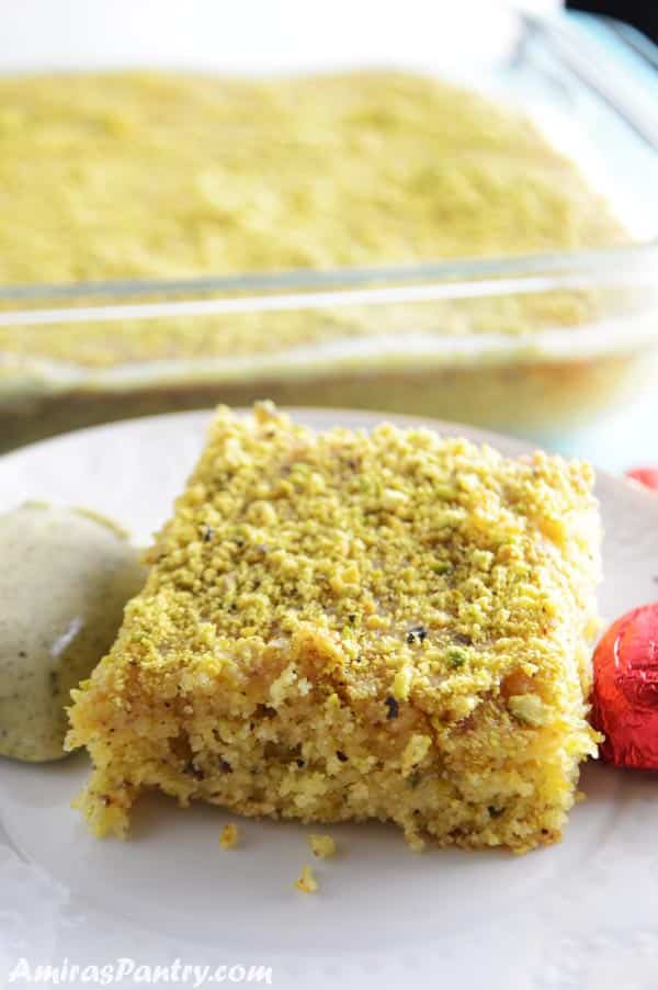 A piece of cake on a plate, with Pistachio and Semolina
