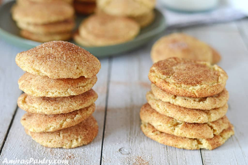 two stacks of snickerdoodle cookies side by side to show difference in shape with different baking times.