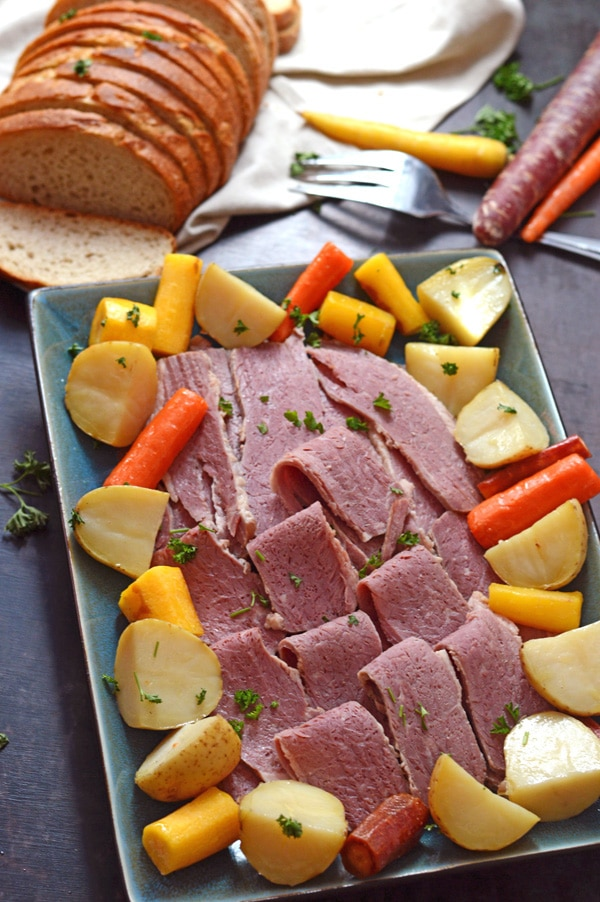 Diced corned beef with veggies a fork on the side and bread.
