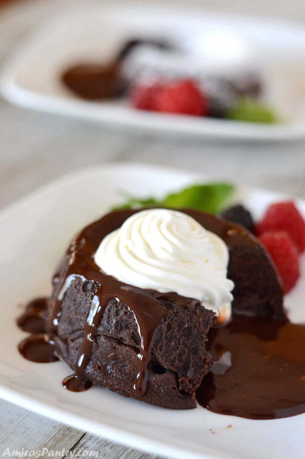 A close up of a piece of chocolate cake on a plate, with Cream