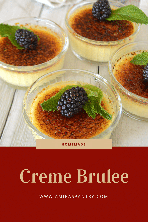 A spoon holding some easy creme brulee with craked caramelized sugar in focus with other ramekins in the background.