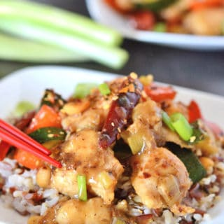 A close up of a plate of food, with Kung Pao chicken