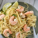 A dish is filled with food, with Shrimp Scampi and Pasta