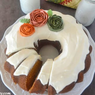 A pumpkin cake photo on a plate with frosting on top