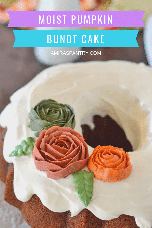 A slice of moist easy pumpkin cake with cream cheese frosting peaking through the whole bundt cake.