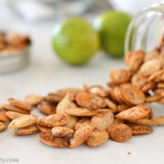 A photo showing roasted pumpkin seeds on a table