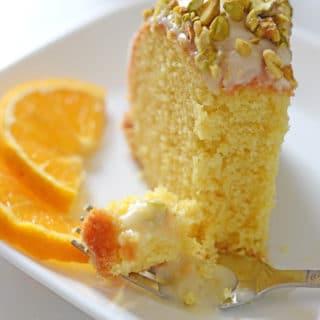 A piece of orange cake on a plate, with Orange
