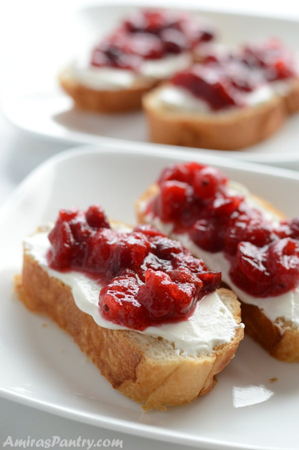 Healthier cranberry sauce spread over bread in a white plate.