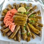 A close up of a plate of food, with Dolmades