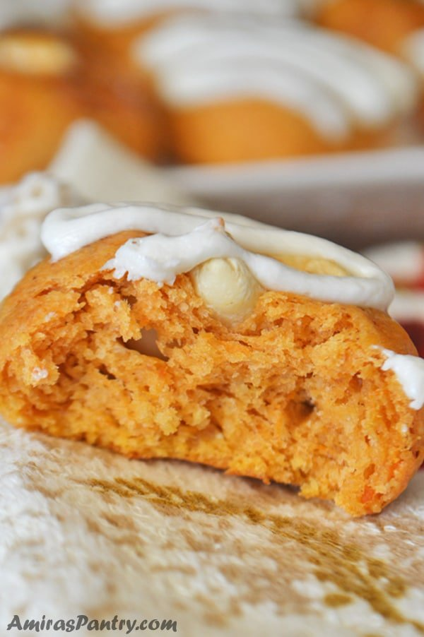 one sweet potato cookie, cut in half and topped with white sauce.