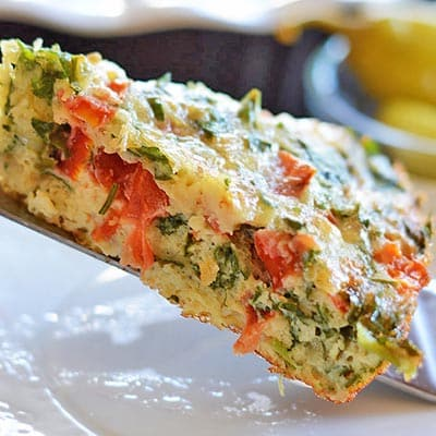 A close up of a slice of frittata