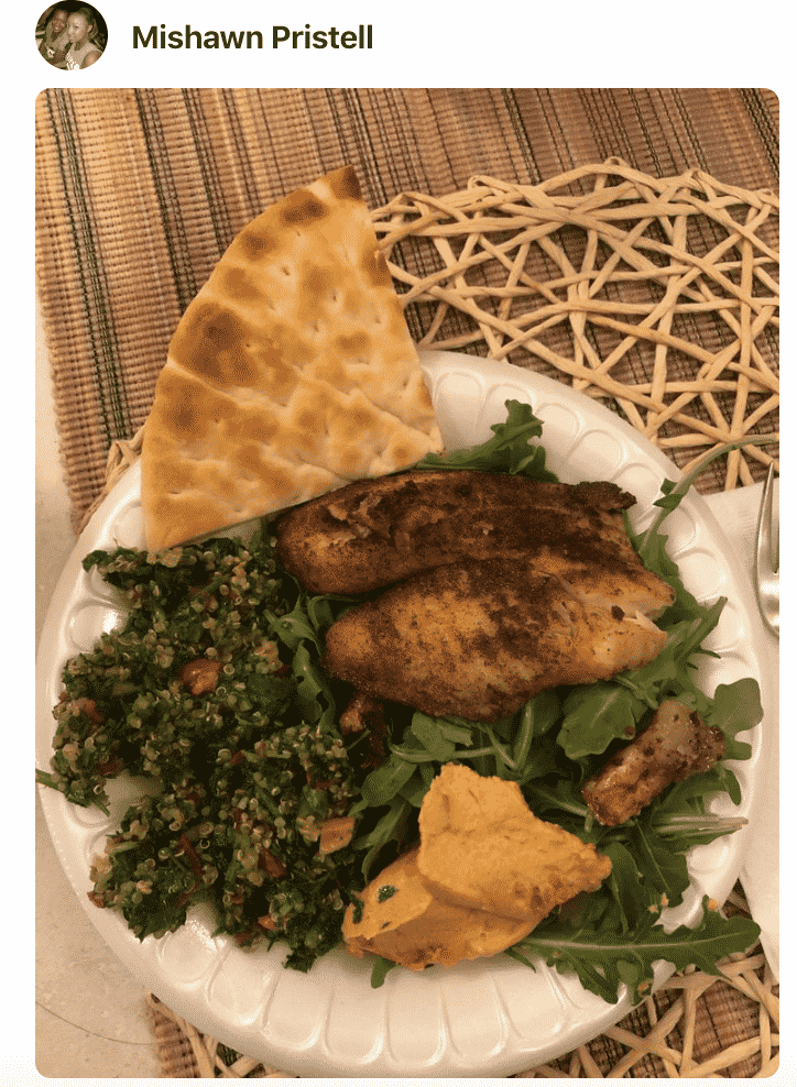 A plate of food with tabbouleh and bread